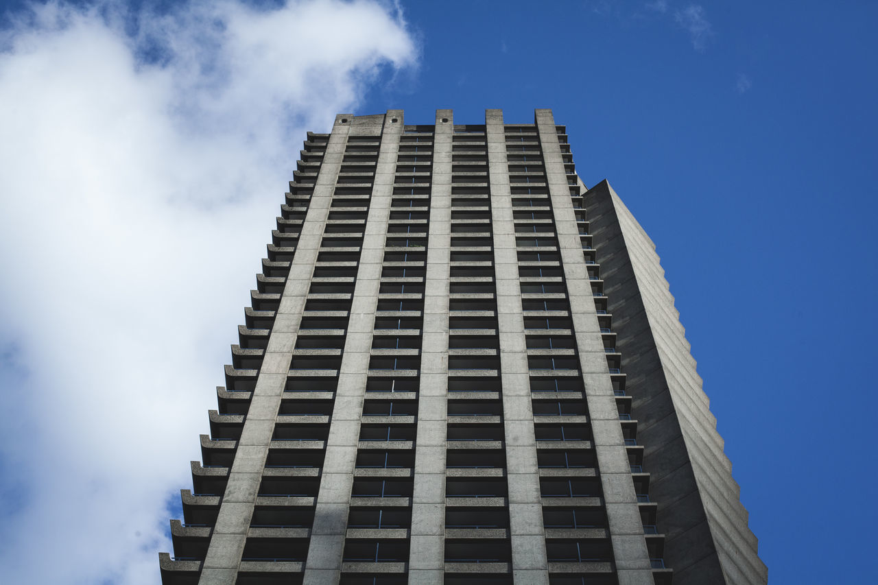 low angle view, architecture, building exterior, built structure, sky, day, skyscraper, blue, modern, outdoors, no people, city