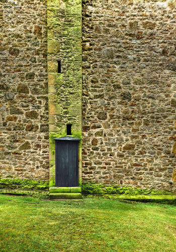 Alte Kirche Alte Kirchenwand Alte Steinwand Architecture Building Exterior Built Structure Church Wall Dark Dark Door Day Door In A Wall Grass Green Color Green Grass Green Lawn Moss No People Old Church Wall Old Stone Wall Outdoors Side Door Steps Wall Wall And Lawn