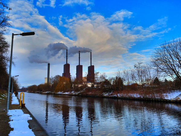 combined heat and power plant Power House Canal Chimney Cloud Cold Days Cold Temperature Cooling Tower Generating Plant Generating Station Heating Plant Heating Station Ice Power Plant Powerhouse Sky Smoke Smokestack Snow Stack Water Water Channel Winter