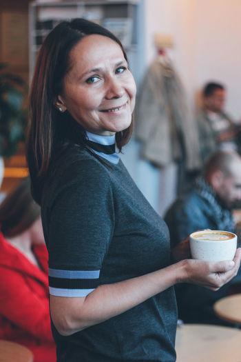 Portrait of a woman drinking coffee