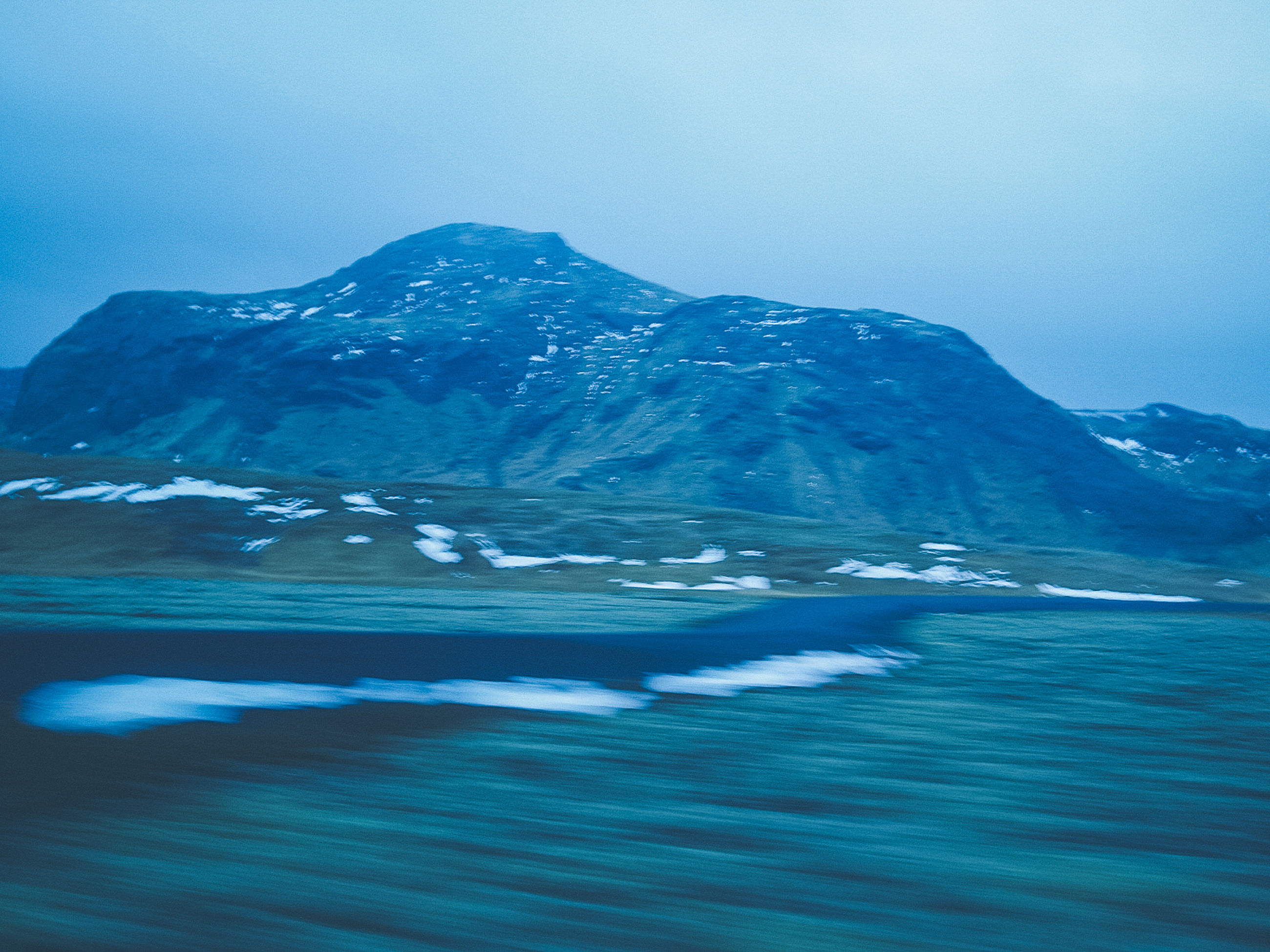 waterfront, mountain, beauty in nature, scenics - nature, water, sky, tranquility, tranquil scene, nature, no people, sea, non-urban scene, day, idyllic, outdoors, cold temperature, winter, blue, motion, mountain peak, snowcapped mountain, purity