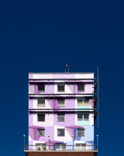 Blueskyarchitecture Sky Low Angle View Architecture No People Built Structure Blue Day Building Exterior Outdoors Sunlight Minimalism Minimalist Photography  Ralfpollack_fotografie Fujix_berlin Building Copy Space Clear Sky Window City Residential District Balcony Purple Apartment