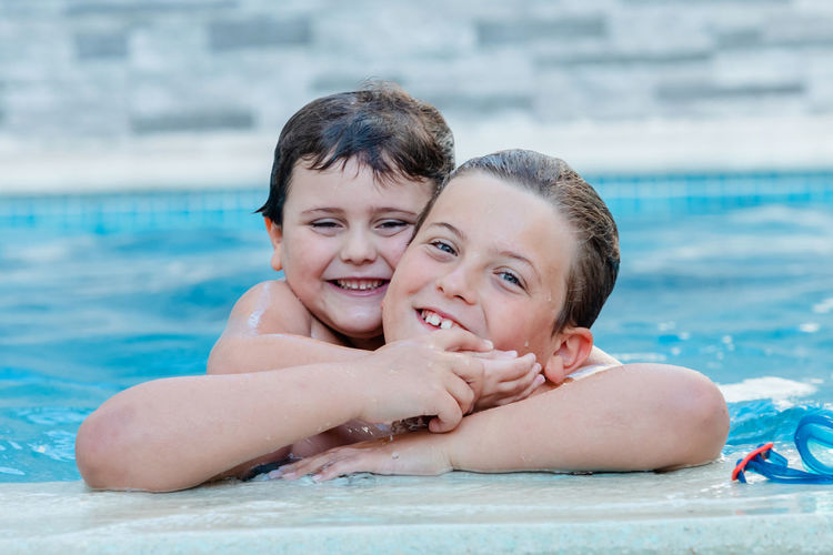 Portrait of mother and daughter at swimming pool
