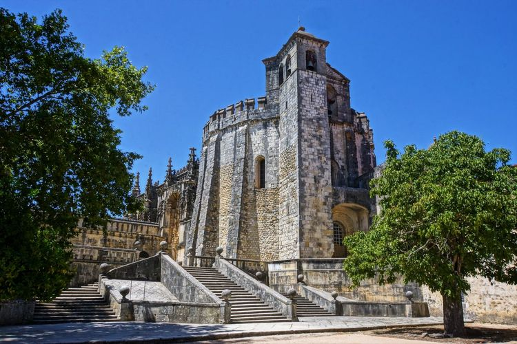 Convento de Christo Architecture Blue Building Exterior Built Structure Church Of The Order Of Christ City Clear Sky Day History Knights Of The Templa Low Angle View Medival Church No People Outdoors Sky Travel Destinations Tree Unesco World Heritage Water