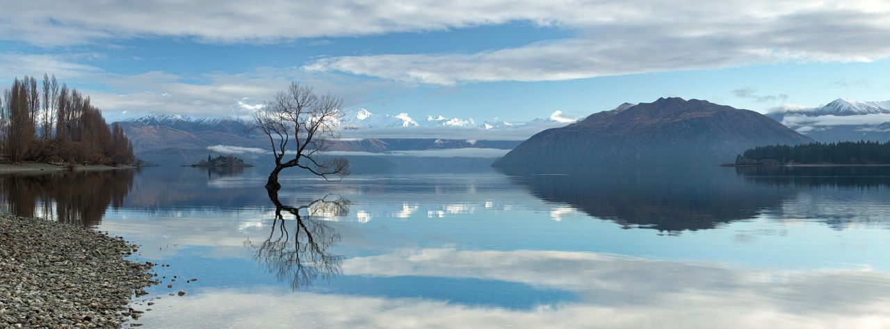 A calm morning at Lake Wanaka, New Zealand Water Reflection Beauty In Nature Scenics - Nature Tranquil Scene Tranquility Cloud - Sky Lake Sky Mountain Nature Waterfront Non-urban Scene Idyllic Tree Day No People Mountain Range Plant Outdoors Wanaka Tree New Zealand Panorama Winter