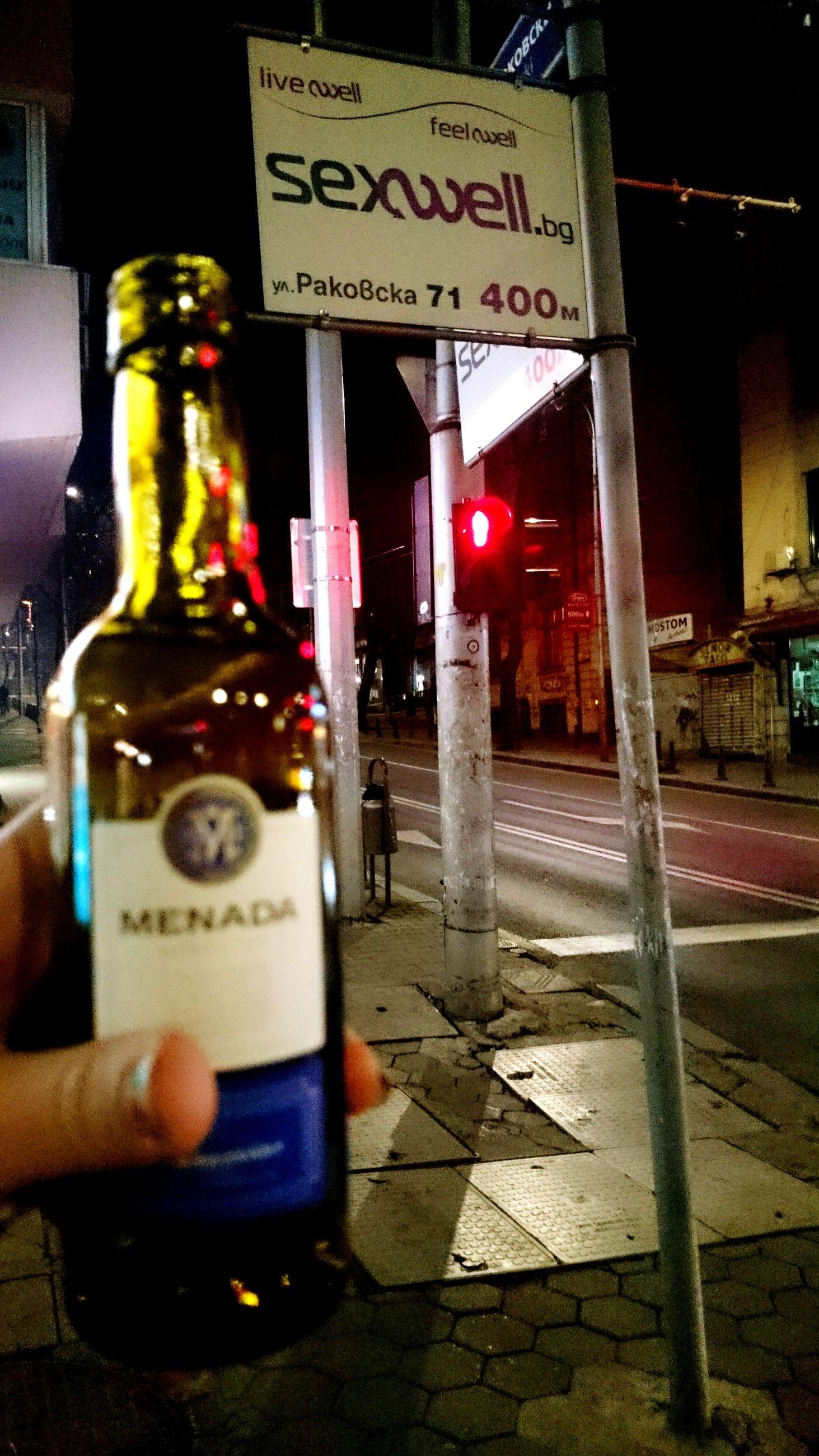 night, illuminated, text, lifestyles, communication, street, holding, men, leisure activity, human representation, western script, city, person, unrecognizable person, incidental people, non-western script, city life