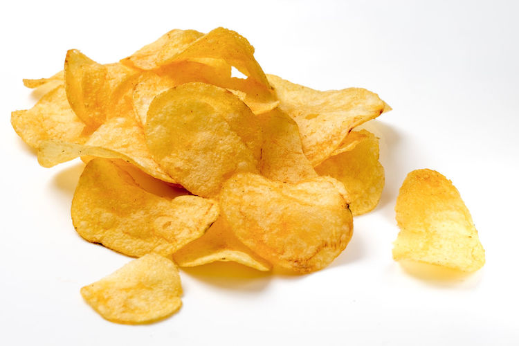 Close-up Crunchy Food Food And Drink Freshness Fried No People Potato Chip Ready-to-eat Snack Still Life Studio Shot Unhealthy Eating White Background Yellow