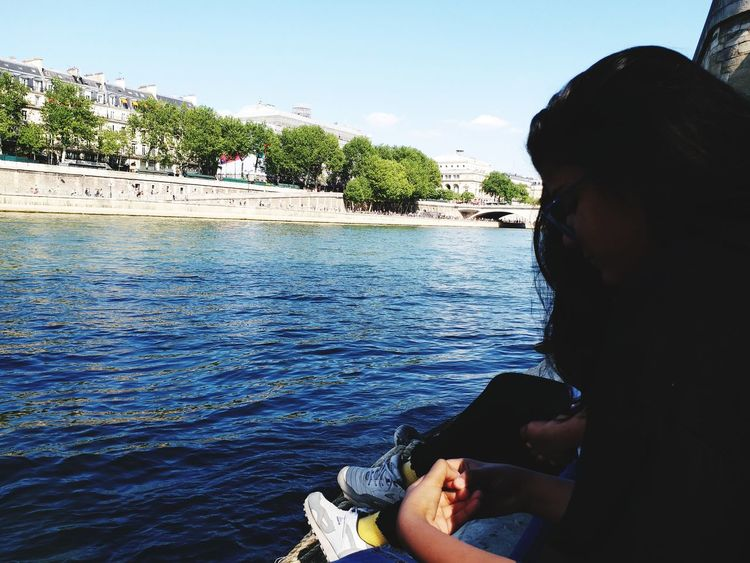 serene siene river Paris EyeemShot Seineriver France EyeEm Selects Water Young Women Sea Relaxation Sitting Beach Summer Rippled Thoughtful Sunbathing Wonderlust Calm Floating On Water Shore Water Surface Day Dreaming