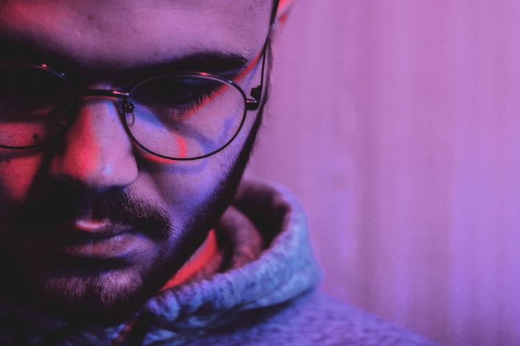 Man wearing eyeglasses in illuminated room