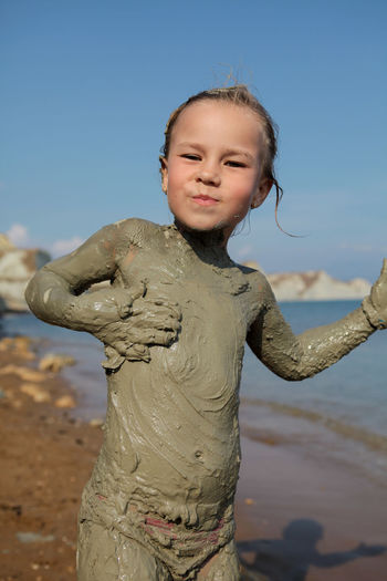 The joy of getting dirty with clay Childhood Child Focus On Foreground Land Sky One Person Beach Standing Innocence Cute Real People Portrait Leisure Activity Lifestyles Outdoors Girl Playing Sand Joy Clay Dirty Soiled