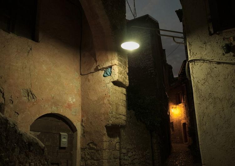 Desert dark alley in Bassiano, Italy. Street lamps and night Alley Back Alley Bassiano Italy Lamps