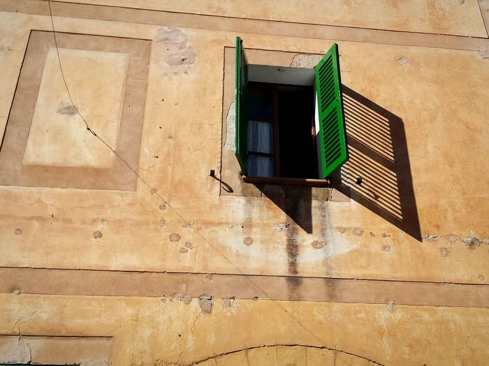 Architecture Window Building Exterior Built Structure No People House Outdoors Day Low Angle View Open Window Light And Shadow Green In Mallorca SPAIN The Graphic City