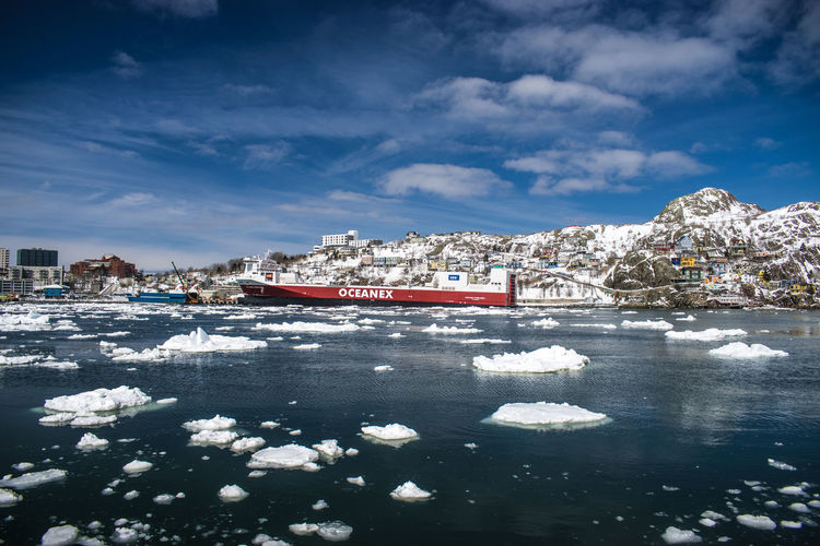 A ship docked in the harbour amidst floating sea ice. Atlantic Canada Blue City Cold Temperature Docked East Coast Floating Harbour Harbour View Ice Flow Nature Nautical Vessel Newfoundland Outdoors Scenics Sea Ice Ship Shipyard Sky Snow St. John's, NL Tourism Travel Destinations Water Winter