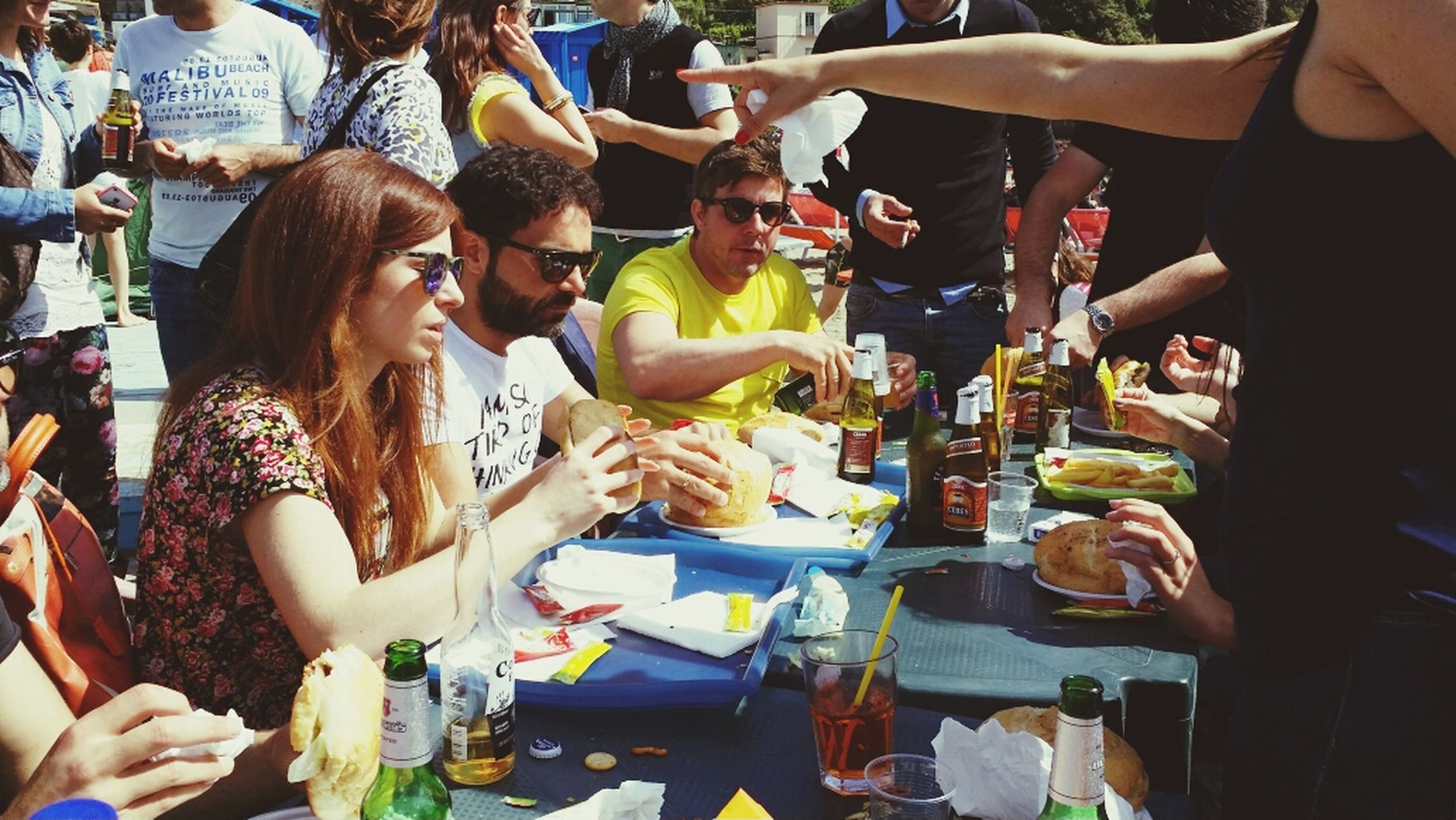lifestyles, togetherness, large group of people, men, person, leisure activity, sitting, friendship, food and drink, medium group of people, holding, indoors, crowd, bonding, restaurant, celebration