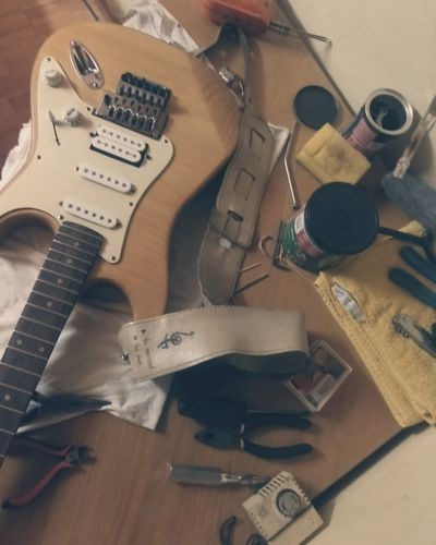 EyeEm Selects Indoors  Arts Culture And Entertainment Table No People Electric Guitar Close-up Day Guitar Workshop Guitar Stratocaster Fender Fender Stratocaster Fenderguitar Tools Work Working Maintenence