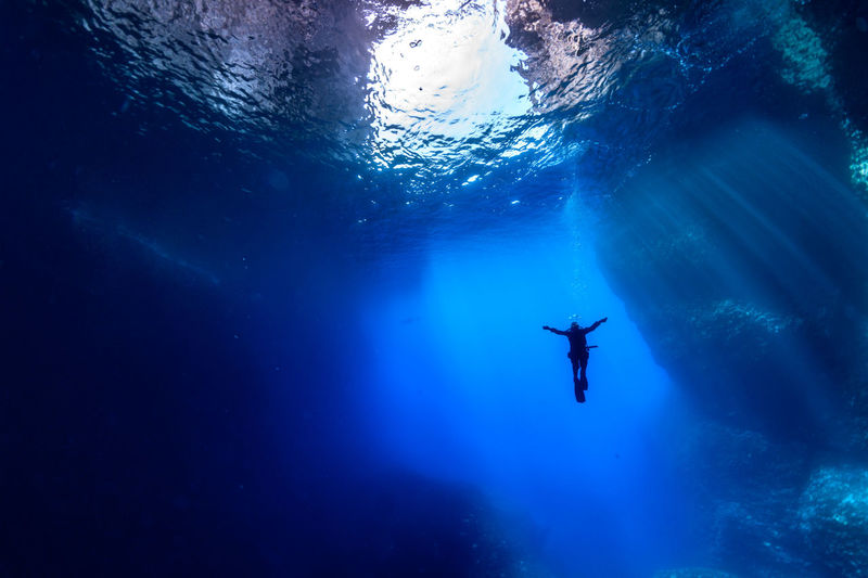 Low angle view of person swimming in sea