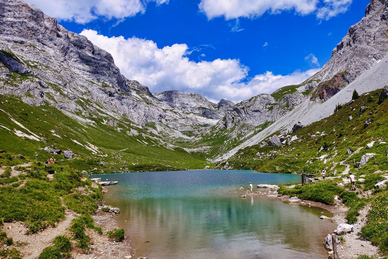 water, mountain, scenics - nature, beauty in nature, cloud - sky, tranquil scene, sky, non-urban scene, lake, tranquility, nature, mountain range, day, idyllic, no people, plant, environment, landscape, outdoors