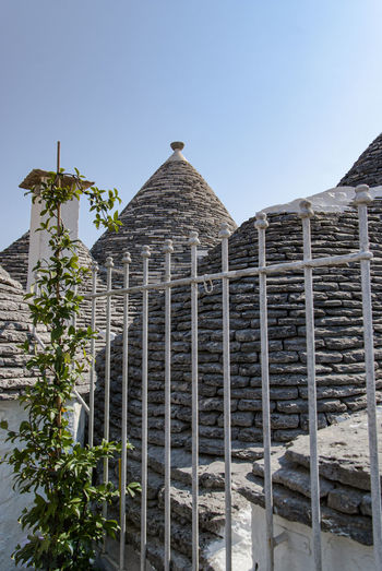 The magic of Alberobello's Trulli travel location - It was really amazing to know this particulars constructions full of charming and to ear the history about the Alberobello's Trulli in the Italy Apulia region (Puglia). The history said that the Alberobello's origins date back to the Middle Age. The settlers built the houses with stone and without cement and with the easiest way to demolish them in the case of an inspection by the Kingdom of Naples, thus avoiding paying taxes. Another interesting thing is the decorative pinnacles and symbols painted on many roofs of the trulli that were often used to identify the different religions of their inhabitants. Albelobelo Italia Viajes  2019 EyeEm Awards The Traveler - 2019 EyeEm Awards The Architect - 2019 EyeEm Awards The Photojournalist - 2019 EyeEm Awards The Street Photographer - 2019 EyeEm Awards Italy EyeEm Gallery EyeEm Best Shots Eyeem4photography Architecture Built Structure Sky Building Exterior Clear Sky Plant Nature No People Day Building Tree Low Angle View The Past History Travel Destinations Outdoors Copy Space Travel Mountain Sunlight Ancient Civilization