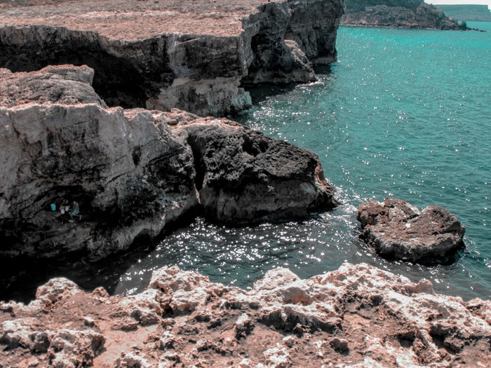 cliffs of Malta Mediterranean  Mediterranean Sea Turquoise Colored Cave Fishermen Water Sea Beach Rock - Object Rocky Coastline Cliff Physical Geography Rocky Mountains Rock Rugged Coast Shore Geology Eroded Rock Formation