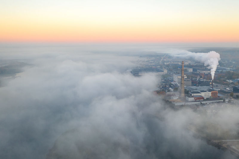 Aerial View Of Industry Emitting Smoke Against Sky