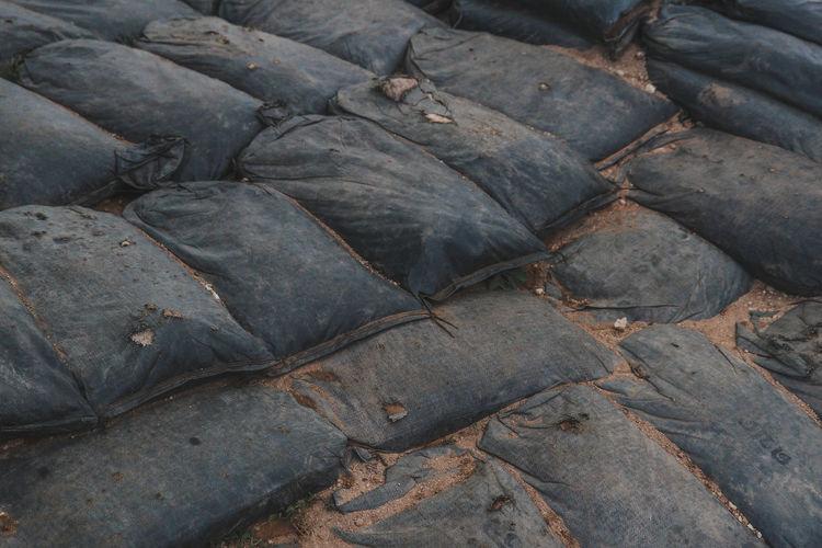 Full frame shot of sacks on sand