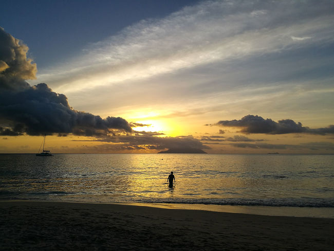 Beach Sunset Water Sea One Person Full Length Tranquility Silhouette Sky Standing Vacations Children Only Summer Sand Nature People Outdoors One Boy Only Childhood Child Yellow Berjaya Beach Seychelles Travel Destinations Vacations Aesthetic Lost In The Landscape