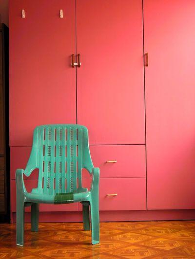 Chair Against Cupboard