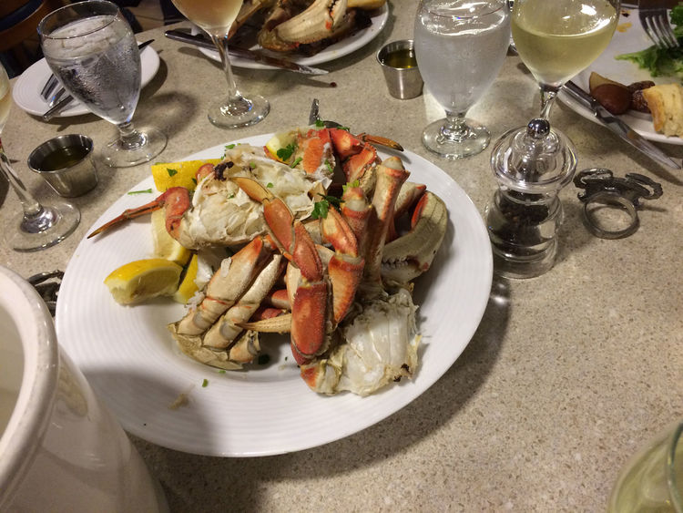 Exploring Alaska's Coastal Wilderness Dinner at the National Geographic Sea Lion ship Close-up Day Drinking Glass Dungeness Crab Dungeness Crab Feast Food Food And Drink Freshness Healthy Eating High Angle View Indoors  No People Plate Ready-to-eat Seafood Serving Size Table