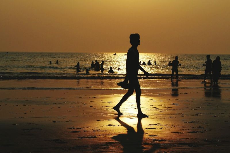 Sunset Beach Water Child Sea Outdoors Silhouette People Nature Sky Adult Only Men Day Golden Sunset Loner Moving Forward  Looking Ahead One Among Strangers Star Swimming People Ocean Awesome Awesome Shot Complete Man Bathing