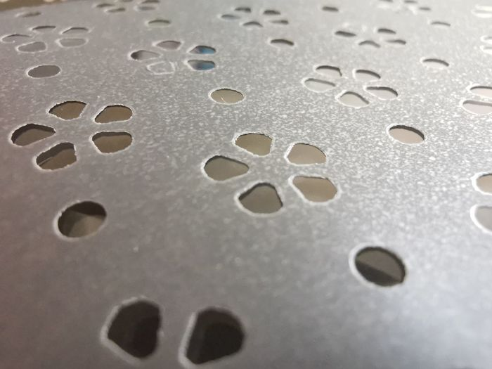 Full frame shot of water drops on paper