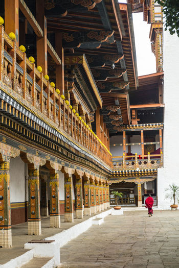Inside the Punakha Dzong in Bhutan Dzong Punakha Punakha Dzong Adult Architectural Column Architecture Bhutan Building Exterior Built Structure Day Full Length History Indoors  Men One Person People Real People Travel Destinations Walking Women