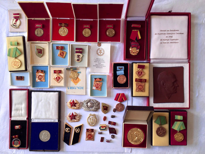 Directly above shot of badges and medals on table