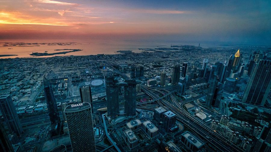 High angle view of city buildings during sunset