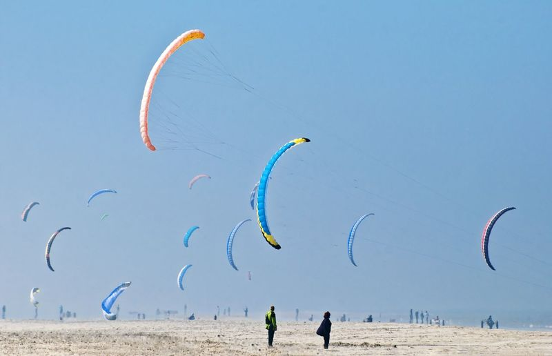 Scenic view of kites against sky