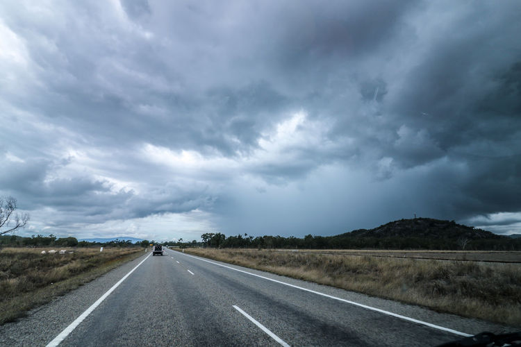 Australia Dark Road Storm Stormy Weather Beauty In Nature Cloud - Sky Day Dividing Line Gray Landscape Nature No People Outdoors Road Road Marking Roadtrip Scenics Sky Storm Cloud Stormy Sky The Way Forward Transportation