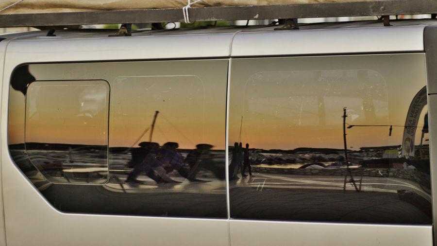People on street seen through glass window