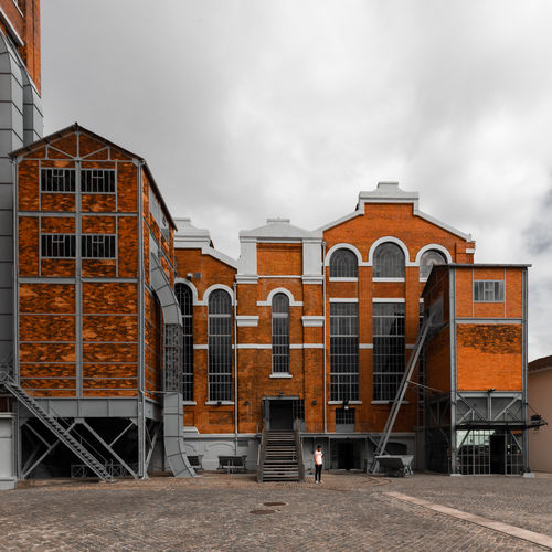 Exterior of buildings against sky in city