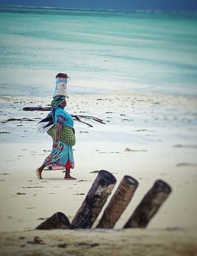 Working woman on her way Land Sea Sand Full Length Day One Person Tranquil Scene Lifestyles Outdoors Horizon Over Water Beauty In Nature