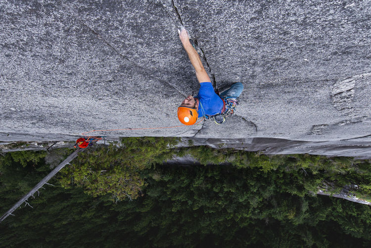 High angle view of man climbing on rope