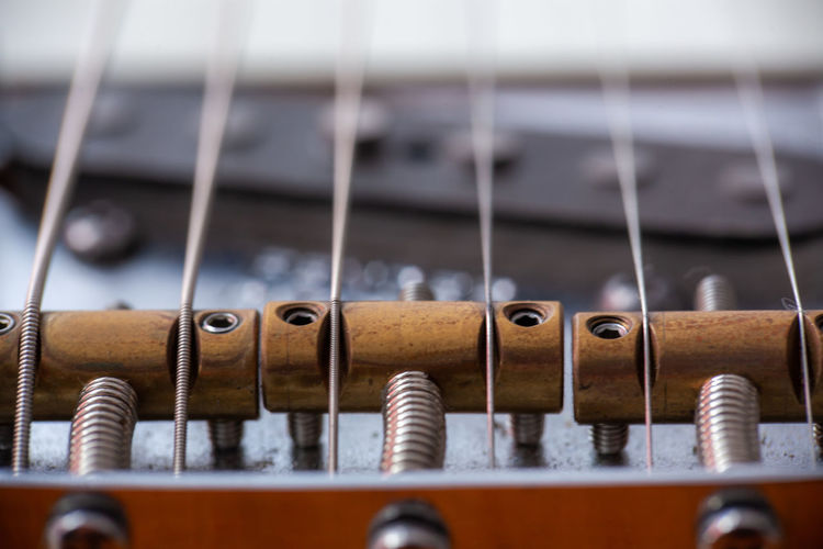 String Instrument Musical Equipment Close-up Selective Focus Musical Instrument Music No People String Arts Culture And Entertainment Musical Instrument String Guitar Metal Full Frame Indoors  Wood - Material Focus On Foreground Day Pattern In A Row Backgrounds EyeEmNewHere
