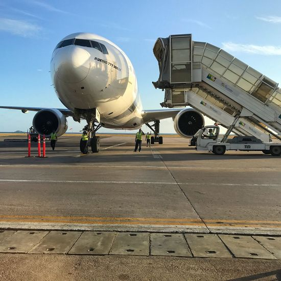 Gangway are approaching the Airplane Emirates Transportation Mode Of Transport Travel Air Vehicle Public Transportation Airport Airport Runway