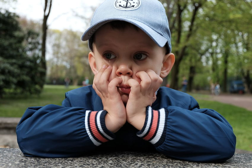 Cap Casual Clothing Close-up Cute Day Focus On Foreground Front View FUJIFILM X-T10 Headshot Leisure Activity Lifestyles Little Boy Outdoors Park Portrait Portrait Photography Sad Face Tears Tree Warm Clothing Wasiak