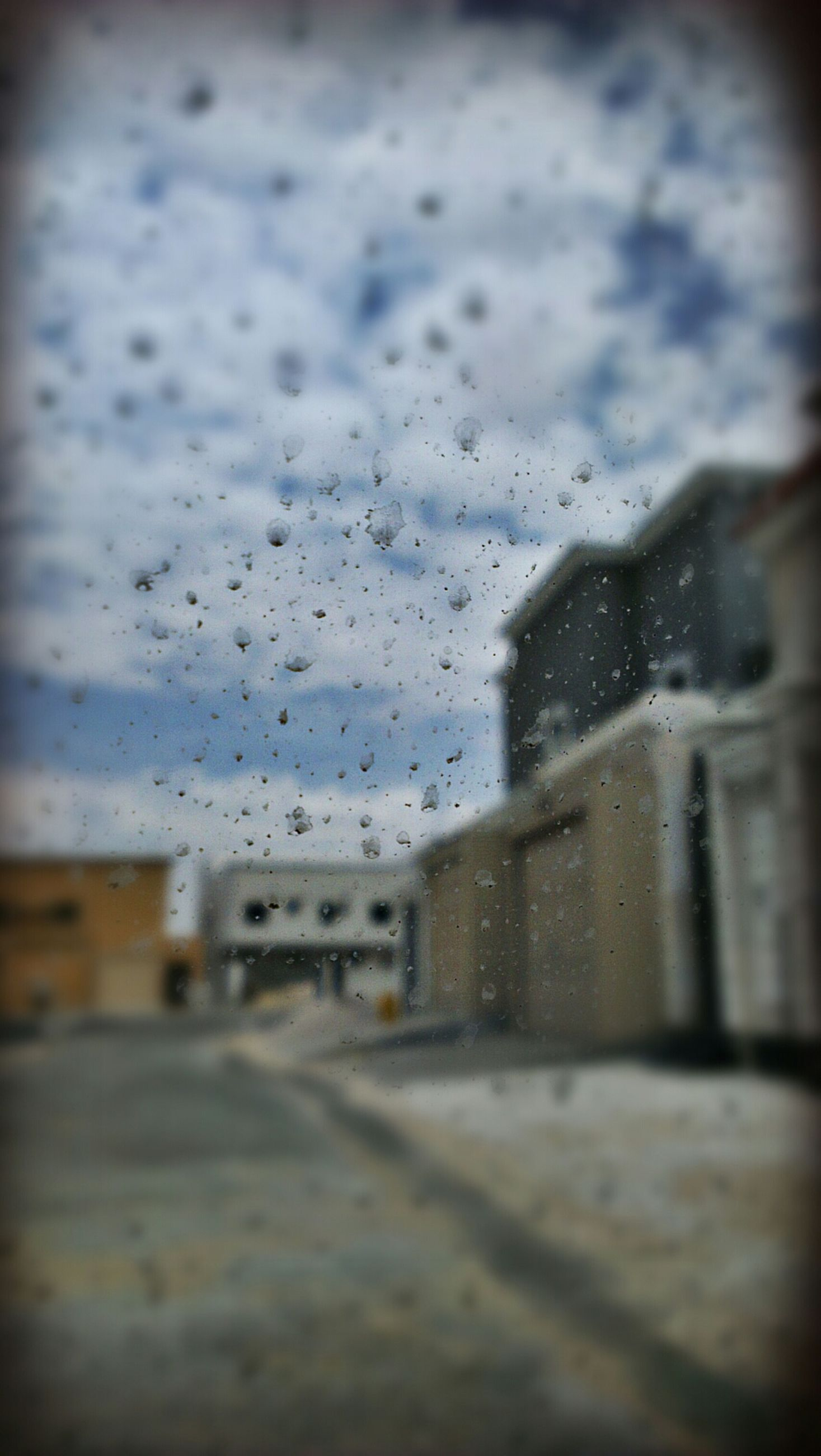 transportation, selective focus, wet, street, road, focus on foreground, sky, window, rain, car, weather, drop, surface level, land vehicle, mode of transport, water, glass - material, transparent, day, outdoors