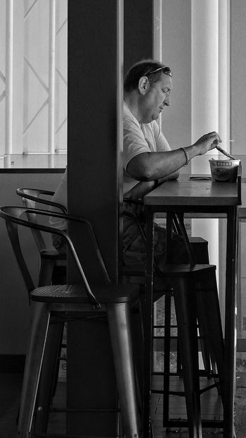 The Street Photographer - 2017 EyeEm Awards Indoors  One Person Sitting Concentration Day Eating Lunch Phuket,Thailand Phuket Airport Man Caucassian
