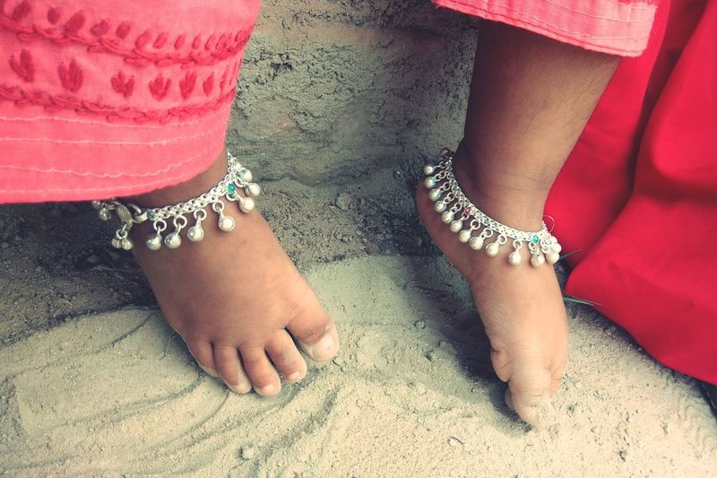 Low section of girls wearing anklet