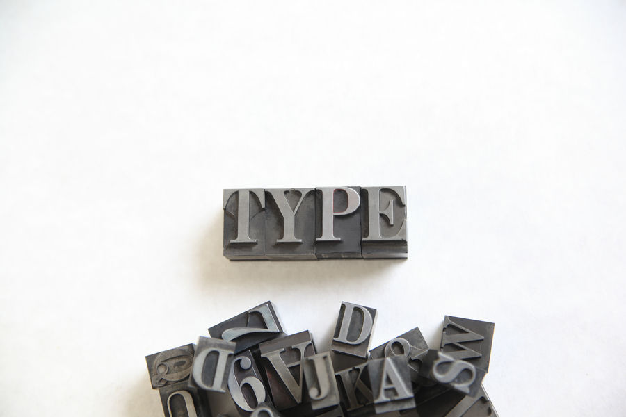 Metal type word with room for text Alphabet Arrangement Copy Space Design Designing Font Gray Grouping Letterpress Type Letters Metal Type Natural Light No People Numbers Overhead Pile Several Studio Shot Textures Type Typography White White Background Word
