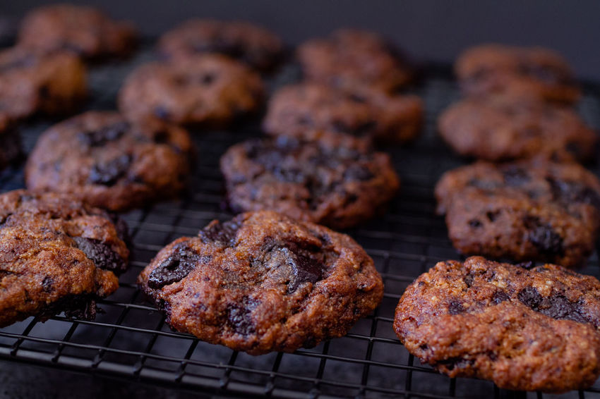 Paleo Chocolate Chunk Cookies on Baking Rack Chocolate Comfort Food Cookies Food Styling Food And Drink Freshly Baked Shadows & Lights Snack Temptation Chocolate Chip Cookies Close Up Close-up Cooling Rack Dark Photography Darkness And Light Food Food And Drink Food Photography Healthy Eating Healthy Food Healthy Lifestyle Indulgence Ready-to-eat Shadow Snacks Food Stories