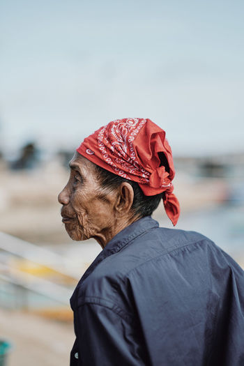 Tawi-Tawi, Philippines. Southermost province of the Philippines. A local in the market where people trade or sell goods. Adult Casual Clothing Clothing Day Focus On Foreground Headshot Leisure Activity Lifestyles Looking Looking Away Males  Men One Person Portrait Profile View Real People Senior Adult Side View Waist Up Warm Clothing Water