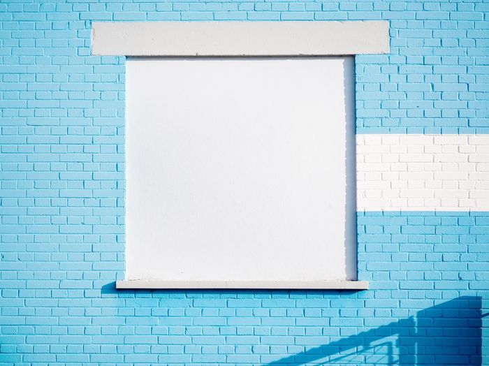 White window on blue wall