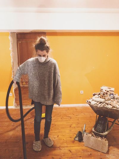 Full length of woman cleaning house